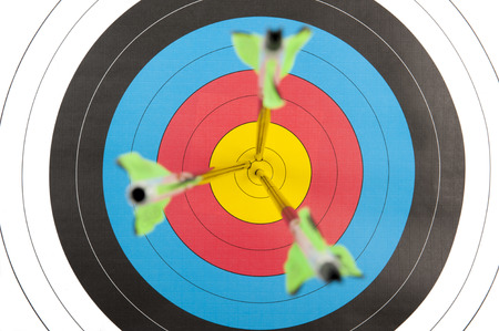 bulls eye: The bulls eye of an archery target with three arrows in short depth of field Stock Photo