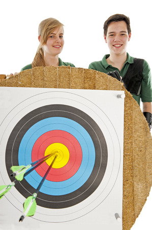 bull's eye: Young girl and boy standing behind the bulls eye