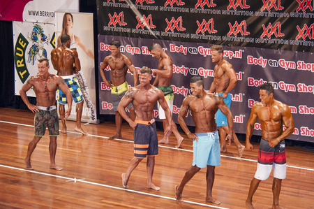 lineup: Male fitness contestants show their physique in a lineup at the 38th Dutch National Championship Bodybuilding and Fitness of the IFBB Netherlands (NBBF) on april 26, 2015 in Theatre aan de Schie at Schiedam, the Netherlands. Winning this A rated Champ