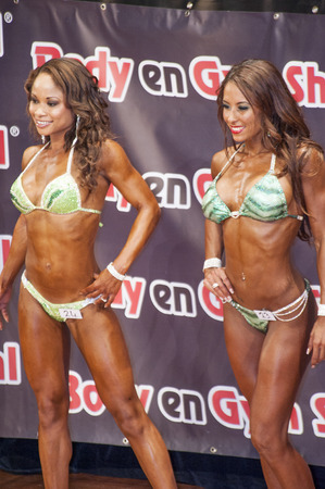 schiedam: Female bikini models showing their best at the 38th Dutch National Championship Bodybuilding and Fitness of the IFBB Netherlands (NBBF) on april 26, 2015 in Theatre aan de Schie at Schiedam, the Netherlands. Winning this A rated Championship leads to  Editorial