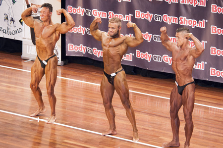 qua: Male bodybuilders showing their best at the 38th Dutch National Championship Bodybuilding and Fitness of the IFBB Netherlands (NBBF) on april 26, 2015 in Theatre aan de Schie at Schiedam, the Netherlands. Winning this A rated Championship leads to qua Editorial