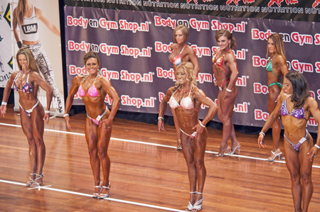 schiedam: Female bikini models  showing their best in a comparison lineup at the 38th Dutch National Championship Bodybuilding and Fitness of the IFBB Netherlands (NBBF) on april 26, 2015 in Theatre aan de Schie at Schiedam, the Netherlands. Winning this A rate Editorial
