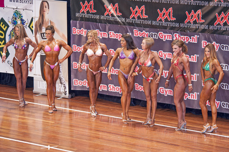 lineup: Female bikini models  showing their best in a comparison lineup at the 38th Dutch National Championship Bodybuilding and Fitness of the IFBB Netherlands (NBBF) on april 26, 2015 in Theatre aan de Schie at Schiedam, the Netherlands. Winning this A rate Editorial