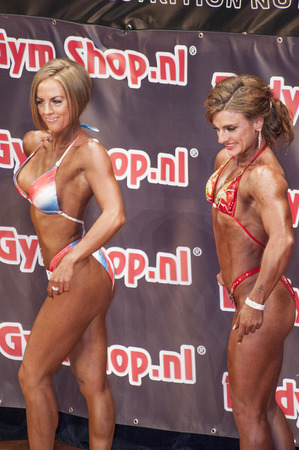 schiedam: Female bikini models  showing their best at the 38th Dutch National Championship Bodybuilding and Fitness of the IFBB Netherlands (NBBF) on april 26, 2015 in Theatre aan de Schie at Schiedam, the Netherlands. Winning this A rated Championship leads to