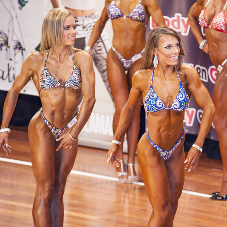 schiedam: SCHIEDAM, THE NETHERLANDS - APRIL 26, 2015: Female bikini models showing their best at the 38th Dutch National Championship Bodybuilding and Fitness of the IFBB Netherlands (NBBF) on april 26, 2015 in Theatre aan de Schie at Schiedam, the Netherlands.