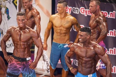 schiedam: SCHIEDAM, THE NETHERLANDS - APRIL 26, 2015. Male bodybuilders showing their best at the 38th Dutch National Championship Bodybuilding and Fitness of the IFBB Netherlands (NBBF) on april 26, 2015 in Theatre aan de Schie at Schiedam, the Netherlands. Editorial