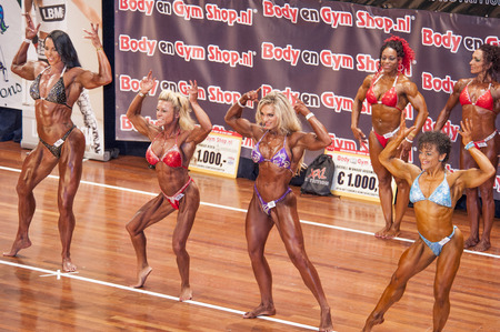 schiedam: SCHIEDAM, THE NETHERLANDS - APRIL 26, 2015: Female bikini models Maria Wattel, Floor van Putten show their best at the 38th Dutch National Championship Bodybuilding and Fitness of the IFBB Netherlands (NBBF) on april 26, 2015 in Theatre aan de Schie at