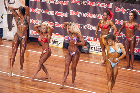 schiedam: SCHIEDAM, THE NETHERLANDS - APRIL 26, 2015: Female bikini models Eveline Nellen, Floor van Putten show their best at the 38th Dutch National Championship Bodybuilding and Fitness of the IFBB Netherlands (NBBF) on april 26, 2015 in Theatre aan de Schie a