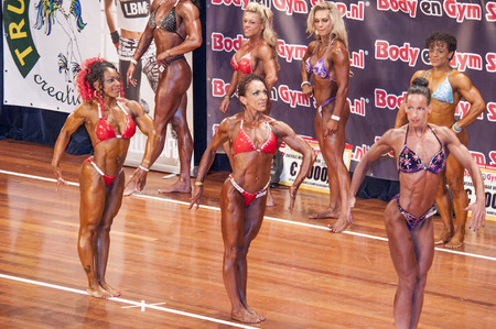 schiedam: SCHIEDAM, THE NETHERLANDS - APRIL 26, 2015: Female bikini models Naima Benamari, Mariska Meuwissen show their best at the 38th Dutch National Championship Bodybuilding and Fitness of the IFBB Netherlands (NBBF) on april 26, 2015 in Theatre aan de Schie  Editorial