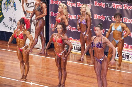schiedam: SCHIEDAM, THE NETHERLANDS - APRIL 26, 2015: Female bikini models Lisandra Chacon, Naima Benamari showing their best at the 38th Dutch National Championship Bodybuilding and Fitness of the IFBB Netherlands (NBBF) on april 26, 2015 in Theatre aan de Schie