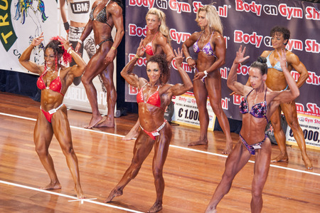 schiedam: SCHIEDAM, THE NETHERLANDS - APRIL 26, 2015: Female bikini models showing Mariska Meuwissen, Floor van Putten their best at the 38th Dutch National Championship Bodybuilding and Fitness of the IFBB Netherlands (NBBF) on april 26, 2015 in Theatre aan de Sc