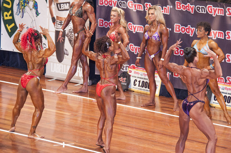 national championship: SCHIEDAM, THE NETHERLANDS - APRIL 26, 2015: Female bikini models Naima Benamari, Evelien Nellen showing their best at the 38th Dutch National Championship Bodybuilding and Fitness of the IFBB Netherlands (NBBF) on april 26, 2015 in Theatre aan de Schie
