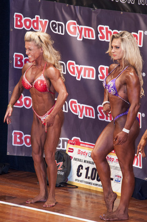 schiedam: SCHIEDAM, THE NETHERLANDS - APRIL 26, 2015: Female bikini models Sylvia Thyssen and Evelien Nellen show their best physique at the 38th Dutch National Championship Bodybuilding and Fitness of the IFBB Netherlands (NBBF) on april 26, 2015 in Theatre aan d