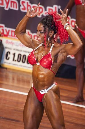 schiedam: SCHIEDAM, THE NETHERLANDS - APRIL 26, 2015: Female bikini models Lisandra Chacon shows her best at the 38th Dutch National Championship Bodybuilding and Fitness of the IFBB Netherlands (NBBF) on april 26, 2015 in Theatre aan de Schie at Schiedam, the Ne