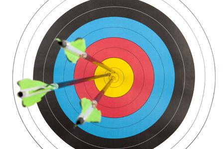 bull's eye: The bulls eye of an archery target hit by three arrows Stock Photo