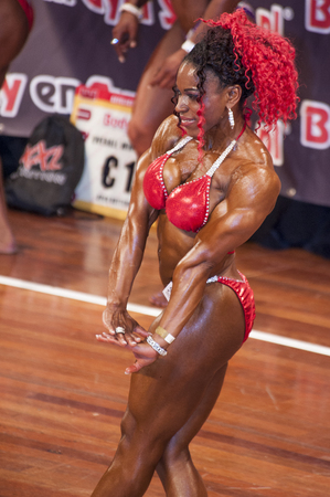 national championship: SCHIEDAM, THE NETHERLANDS - APRIL 26, 2015: Female bikini model Lisandra Chacon shows her best triceps pose at the 38th Dutch National Championship Bodybuilding and Fitness of the IFBB Netherlands (NBBF) on april 26, 2015 in Theatre aan de Schie at Schi