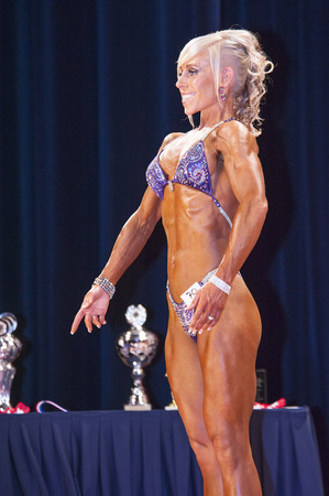 schiedam: SCHIEDAM, THE NETHERLANDS - APRIL 26, 2015: Female bikini model Jennifer van der Wal shows her best at the 38th Dutch National Championship Bodybuilding and Fitness of the IFBB Netherlands (NBBF) on april 26, 2015 in Theatre aan de Schie at Schiedam, th