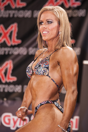 national championship: SCHIEDAM, THE NETHERLANDS - APRIL 26, 2015: Female bikini model Lesley Barents shows her best front pose at the 38th Dutch National Championship Bodybuilding and Fitness of the IFBB Netherlands (NBBF) on april 26, 2015 in Theatre aan de Schie at Schieda Editorial