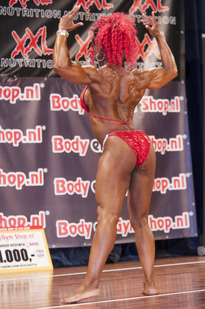 national championship: SCHIEDAM, THE NETHERLANDS - APRIL 26, 2015: Female bikini fitness and physique model Lisandra Chacon shows her best at the 38th Dutch National Championship Bodybuilding and Fitness of the IFBB Netherlands (NBBF) on april 26, 2015 in Theatre aan de Schie
