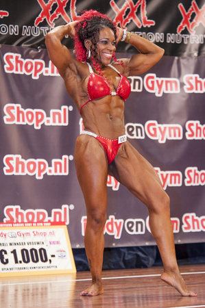 schiedam: SCHIEDAM, THE NETHERLANDS - APRIL 26, 2015: Female bikini fitness and physique model Lisandra Chacon shows her best at the 38th Dutch National Championship Bodybuilding and Fitness of the IFBB Netherlands (NBBF) on april 26, 2015 in Theatre aan de Schie