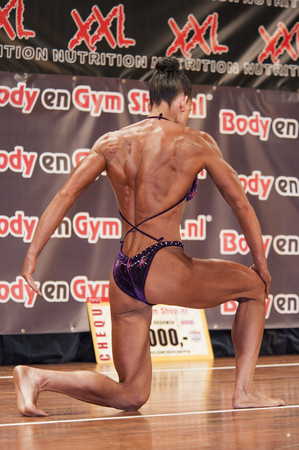 schiedam: SCHIEDAM, THE NETHERLANDS - APRIL 26, 2015: Female bikini fitness and physique model Mariska Meuwissen shows her best at the 38th Dutch National Championship Bodybuilding and Fitness of the IFBB Netherlands (NBBF) on april 26, 2015 in Theatre aan de Schi