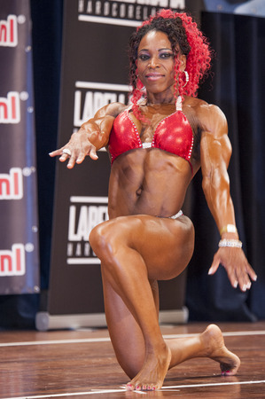 schiedam: SCHIEDAM, THE NETHERLANDS - APRIL 26, 2015: Female bikini fitness model Lisandra Chacon shows her best at the 38th Dutch National Championship Bodybuilding and Fitness of the IFBB Netherlands (NBBF) on april 26, 2015 in Theatre aan de Schie at Schiedam,
