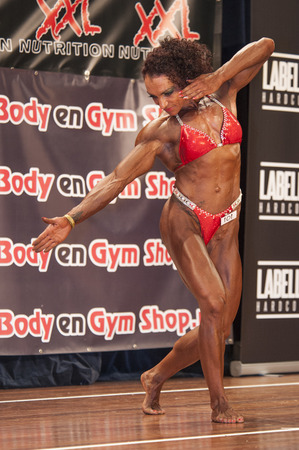 schiedam: SCHIEDAM, THE NETHERLANDS - APRIL 26, 2015: Female bikini fitness and physique model Naima Benamari shows her best at the 38th Dutch National Championship Bodybuilding and Fitness of the IFBB Netherlands (NBBF) on april 26, 2015 in Theatre aan de Schie  Editorial