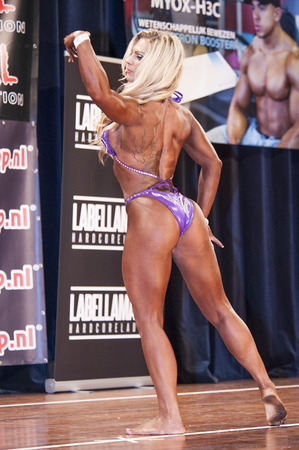 national championship: SCHIEDAM, THE NETHERLANDS - APRIL 26, 2015: Female bikini fitness model Evelien Nellen shows her best at the 38th Dutch National Championship Bodybuilding and Fitness of the IFBB Netherlands (NBBF) on april 26, 2015 in Theatre aan de Schie at Schiedam,  Editorial
