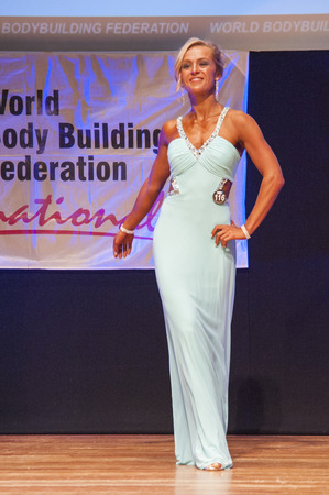 physique: MAASTRICHT, THE NETHERLANDS - OCTOBER 25, 2015: Female fitness model Larissa van Meerten in evening dress shows her best physique in championship on stage at the World Grandprix Bodybuilding and Fitness of the WBBF-WFF on October 25, 2015 at the MECC Thea