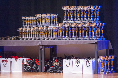 goodie: MAASTRICHT, THE NETHERLANDS - OCTOBER 25, 2015: Table of thophies and goodie bags at championship at the World Grandprix Bodybuilding and Fitness of the WBBF-WFF on October 25, 2015 at the MECC Theatre in Maastricht, the Netherlands.