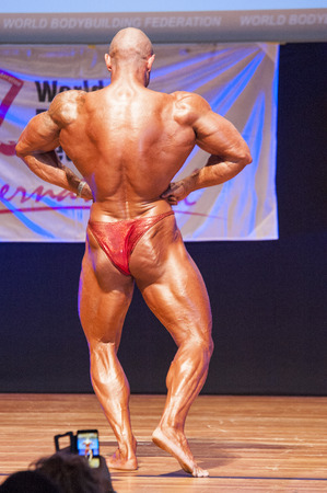 lats: MAASTRICHT, THE NETHERLANDS - OCTOBER 25, 2015: Male bodybuilder Aron Winnelinckx shows his best lats spread pose at championship on stageat the World Grandprix Bodybuilding and Fitness of the WBBF-WFF on October 25, 2015 at the MECC Theatre in Maastricht