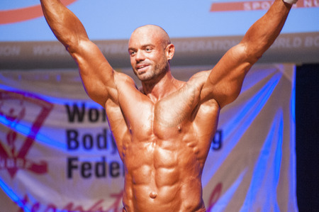 nether: MAASTRICHT, THE NETHERLANDS - OCTOBER 25, 2015: Male bodybuilder Aron Winnelinckx shows his best pose at championship on stageat the World Grandprix Bodybuilding and Fitness of the WBBF-WFF on October 25, 2015 at the MECC Theatre in Maastricht, the Nether