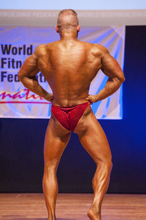 lats: MAASTRICHT, THE NETHERLANDS - OCTOBER 25, 2015: Male bodybuilder flexes his muscles and shows his best lats spread pose at the World Grandprix Bodybuilding and Fitness of the WBBF-WFF on October 25, 2015 at the MECC Theatre in Maastricht, the Netherlands. Editorial