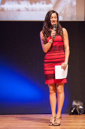 MAASTRICHT, THE NETHERLANDS - OCTOBER 25, 2015: Master of ceremonies behind pulpit addresses theatre crowd with microphone at the World Grandprix Bodybuilding and Fitness of the WBBF-WFF on October 25, 2015 at the MECC Theatre in Maastricht, the Netherlan Editorial