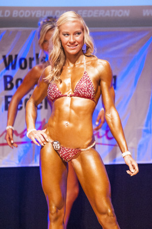 nether: MAASTRICHT, THE NETHERLANDS - OCTOBER 25, 2015: Female fitness bikini model shows her best front pose at championship on stageat the World Grandprix Bodybuilding and Fitness of the WBBF-WFF on October 25, 2015 at the MECC Theatre in Maastricht, the Nether Editorial