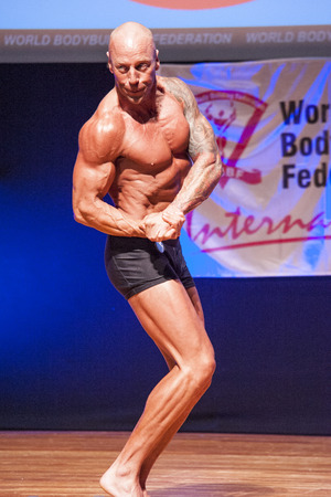 MAASTRICHT, THE NETHERLANDS - OCTOBER 25, 2015: Male bodybuilder Erik Stobbe shows his best chest pose at the World Grandprix Bodybuilding and Fitness of the WBBF-WFF on October 25, 2015 at the MECC Theatre in Maastricht, the Netherlands.