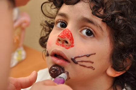 A boy being masked to start having fun