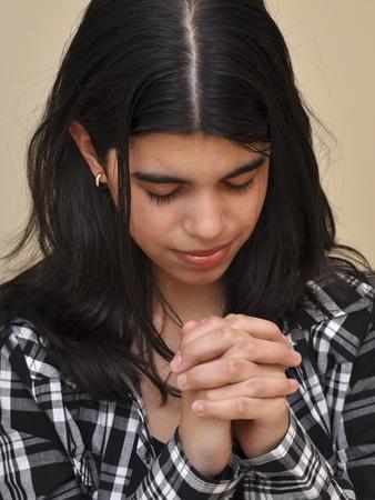 reverent: A reverent girl prays first thing in the morning Stock Photo