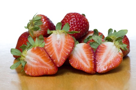 sectioned: A beautiful set of strawberries, some sectioned to show their freshness Stock Photo