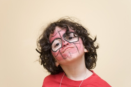 A spiderman masked boy enjoys the final moments of a birthday party Stock Photo