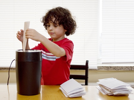 A boy helps destroy personal information Stock Photo
