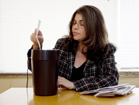 A woman shreds her personal information
