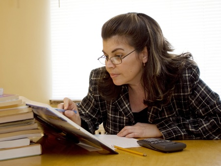 applies: A woman applies to herself to study Stock Photo
