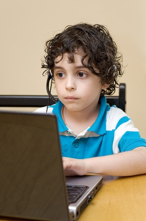 computer: A child handles a computer Stock Photo