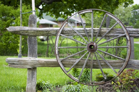 An old wagon wheel displayed as a garden decoration Stock Photo