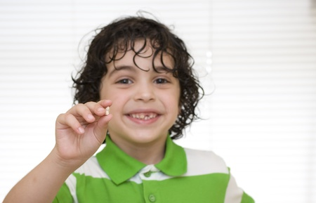 A boy proudly shows his first lost milk tooth Stock Photo - 9924771