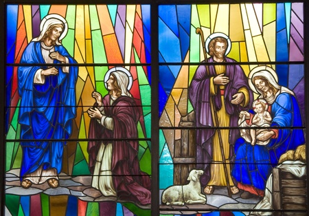 A stained glass portrait of Christ being born Editorial