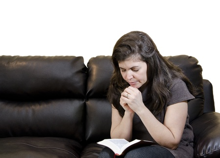 A woman having her daily Christian devotional photo