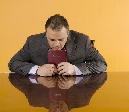 Daily devotional of a Hispanic business man photo