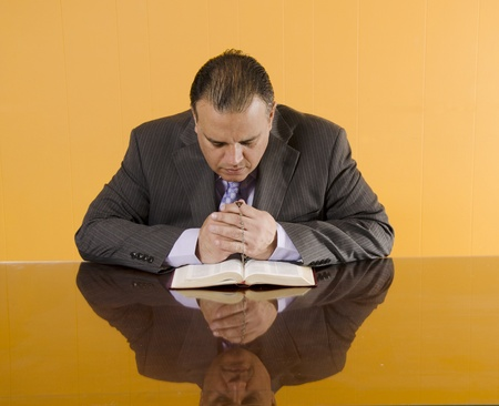 Business man praying in his daily devotional photo